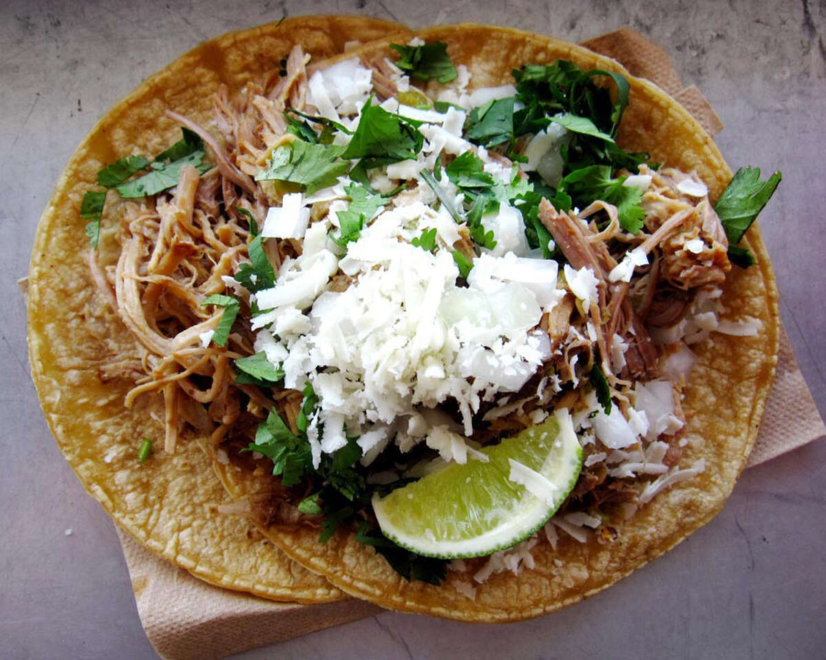 Doesn't suck: Green Chile Pork, this one from the Torchy's in San Antonio. Because sometimes the simple pleasures say it loudest. Just carnitas with green chile, cotija cheese, onions, cilantro and lime. (Mike Sutter/San Antonio Express-News)