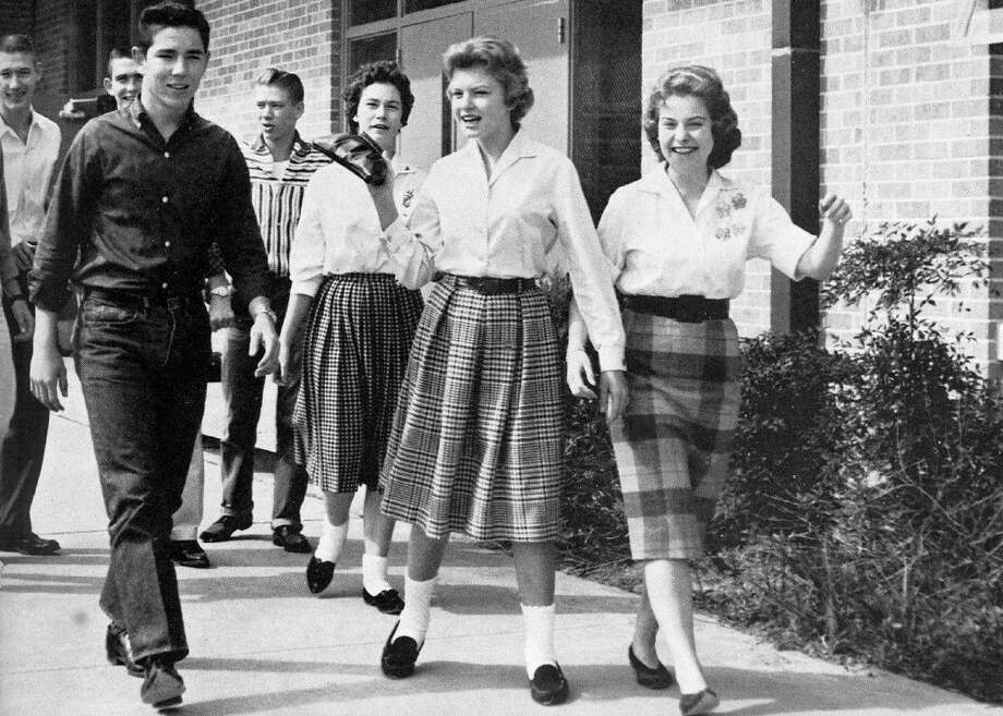 : South Houston students take a stroll to the cafeteria in 1961. In the front are Dwane Sample, Judy Reid and Lynda Lane, all Class of 1962.