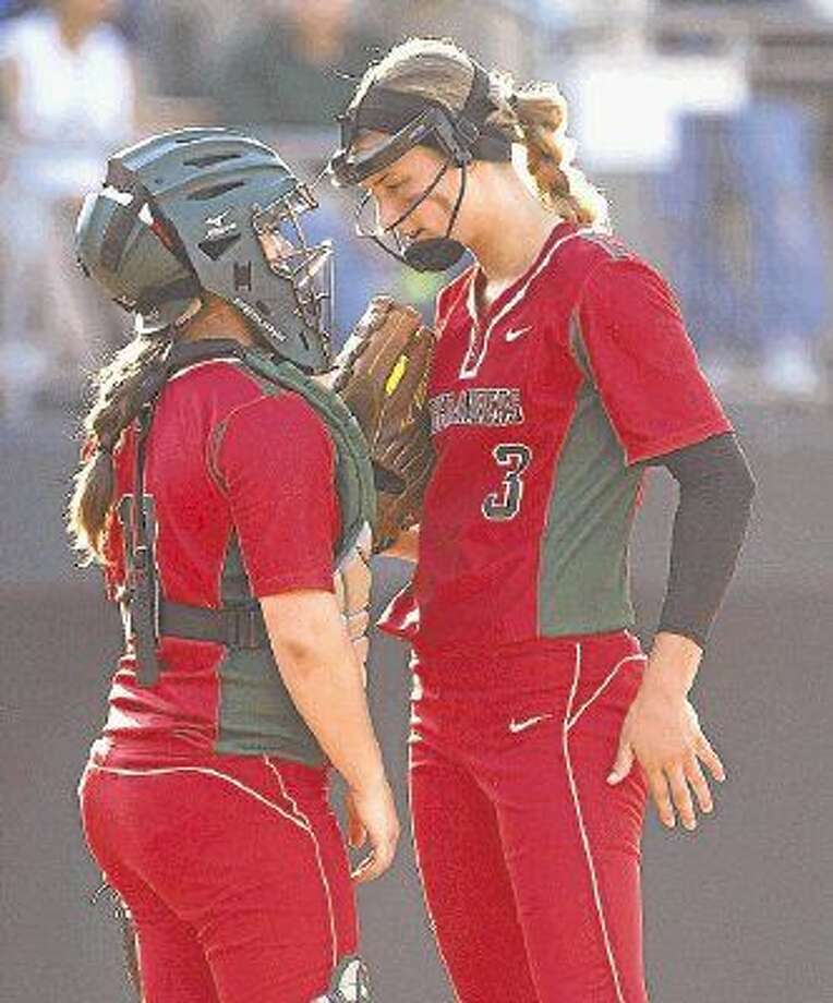The Woodlands pitcher Abby Langkamp, right, and catcher Kelcy Leach confer in last year's state tournament. The Lady Highlanders open District 16-6A play tonight against Atascocita.