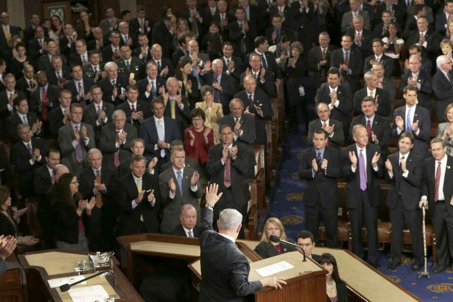 "Israeli Prime Minister Benjamin Netanyahu waves after speaking before a joint meeting of Congress on Capitol Hill in Washington, Tuesday, March 3, 2015. In a speech that stirred political intrigue in two countries, Netanyahu told Congress that negotiations underway between Iran and the U.S. would ""all but guarantee"" that Tehran will get nuclear weapons, a step that the world must avoid at all costs. Photo: STF"