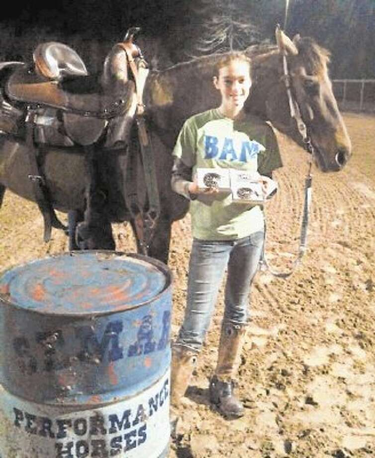 Cleveland student Kyra Lewis is using barrel racing events to raise money for her foundation, which promotes awareness of Addison's disease. Kyra was diagnosed with the disease at the age of 10. Now 14, Kyra has won several belt buckles throughout her barrel racing career. Photo: Submitted Photo / @WireImgId=2667330