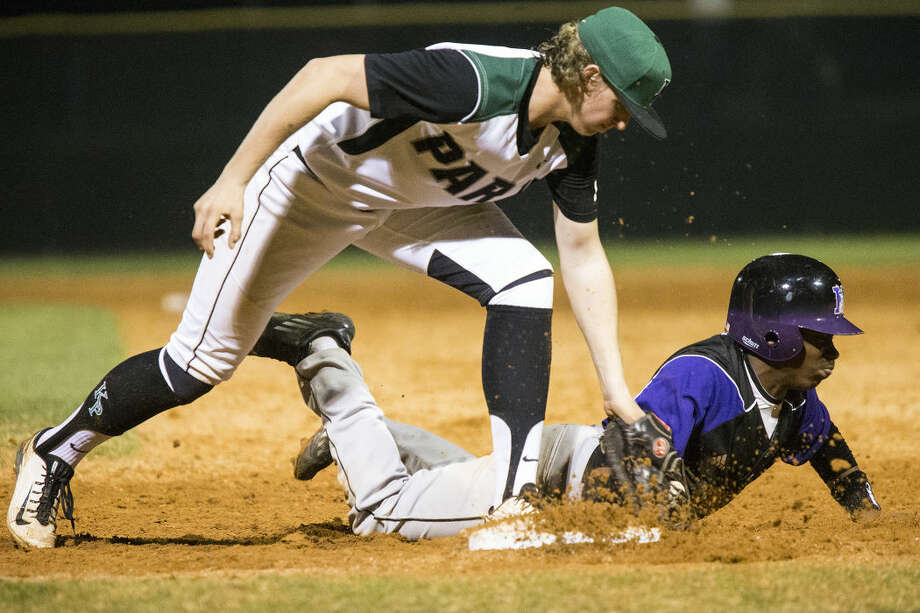 Panthers first baseman Curtis Rhodes (13) attempts to tag Humble's Tyrese Clayborne (1) out at first base during Kingwood Park's 3-0 victory over Humble on March 3, 2015, at Kingwood Park High School. Photo: ANDREW BUCKLEY