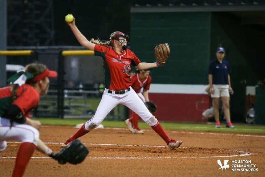 The Woodlands' Emily Langkamp winds up for a pitch against Atascocita during the high school softball game on Tuesday at The Woodlands High School.