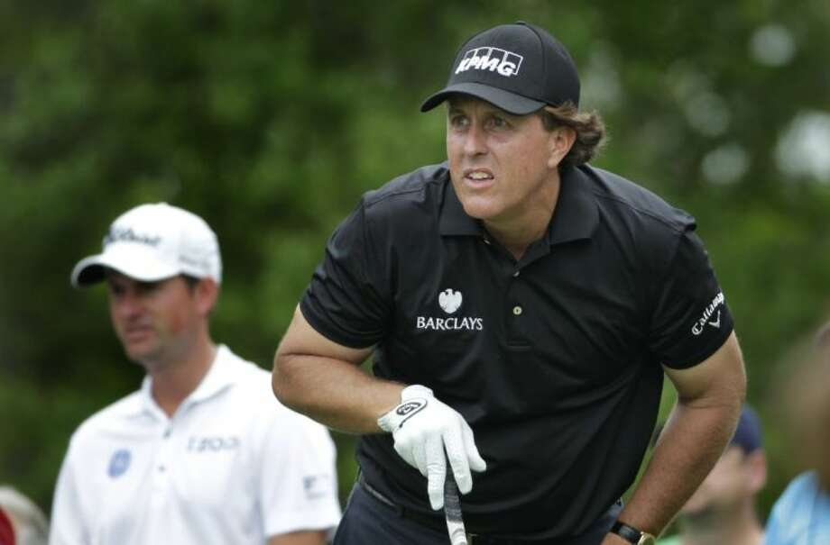 Phil Mickelson watches his drive on the fifth hole during the first round of the Shell Houston Open Thursday in Humble.