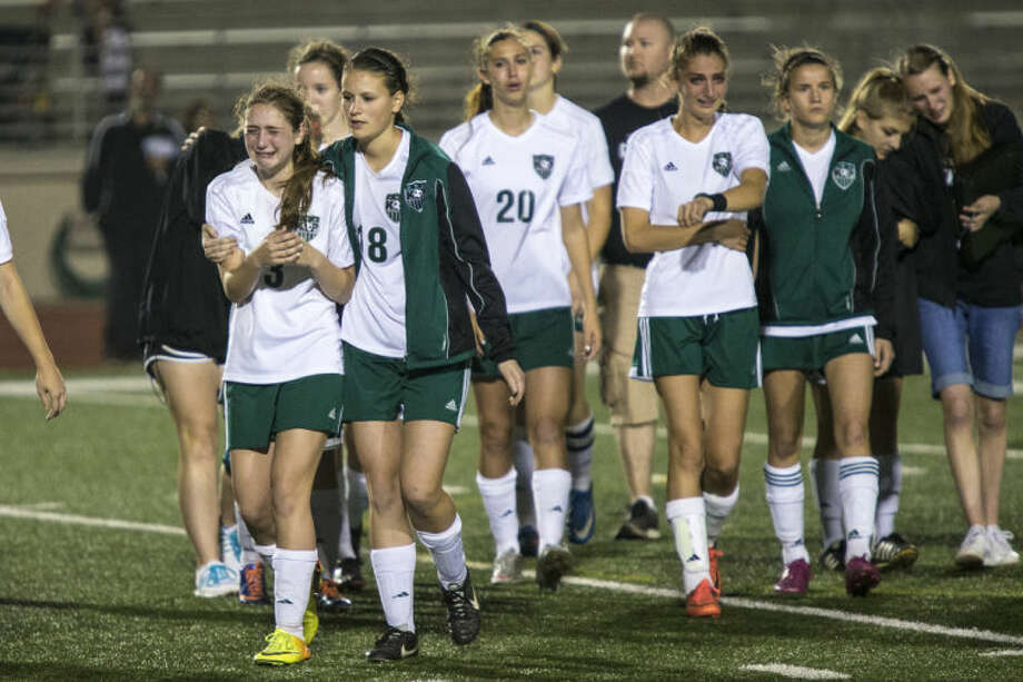 Kingwood Park leaves the field after Kingwood Park's 3-2 playoff loss to Spring Woods on April 3, 2014, at Turner Stadium in Humble. (Photo by ANDREW BUCKLEY/The Observer) Photo: ANDREW BUCKLEY
