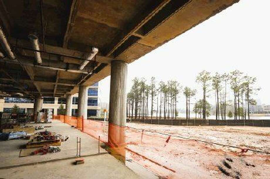 Three Hughes Landing, a 12-story, 321,000-square-foot Class A office building overlooking Lake Woodlands, is one of five Class A office buildings set to open this year in The Woodlands. Photo: Michael Minasi
