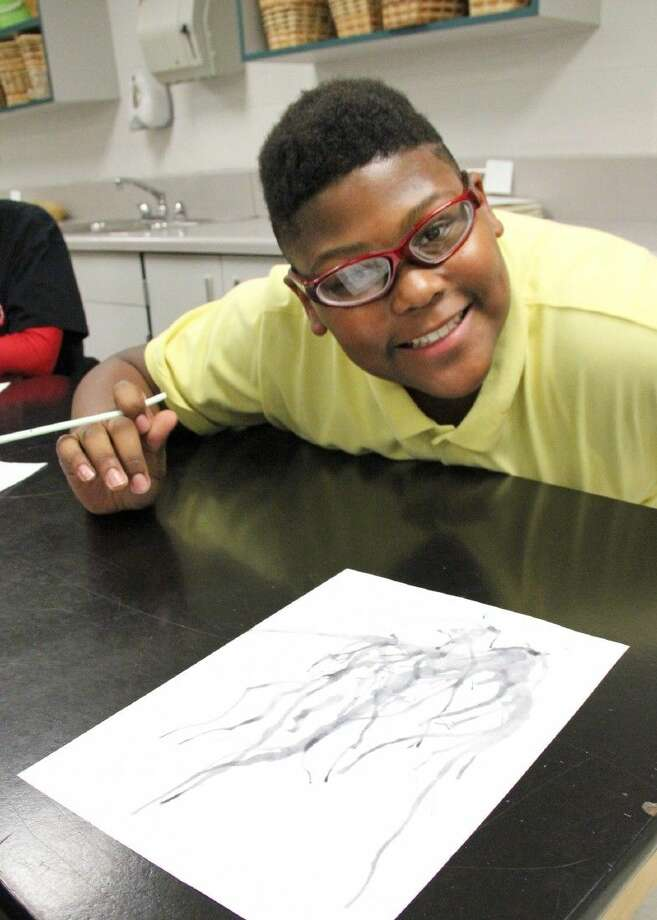 Sam Jamison Middle School's Michael Samson uses a Japanese straw-blowing technique to create unique art during a 21st Century Community Learning Center after-school art enrichment class.
