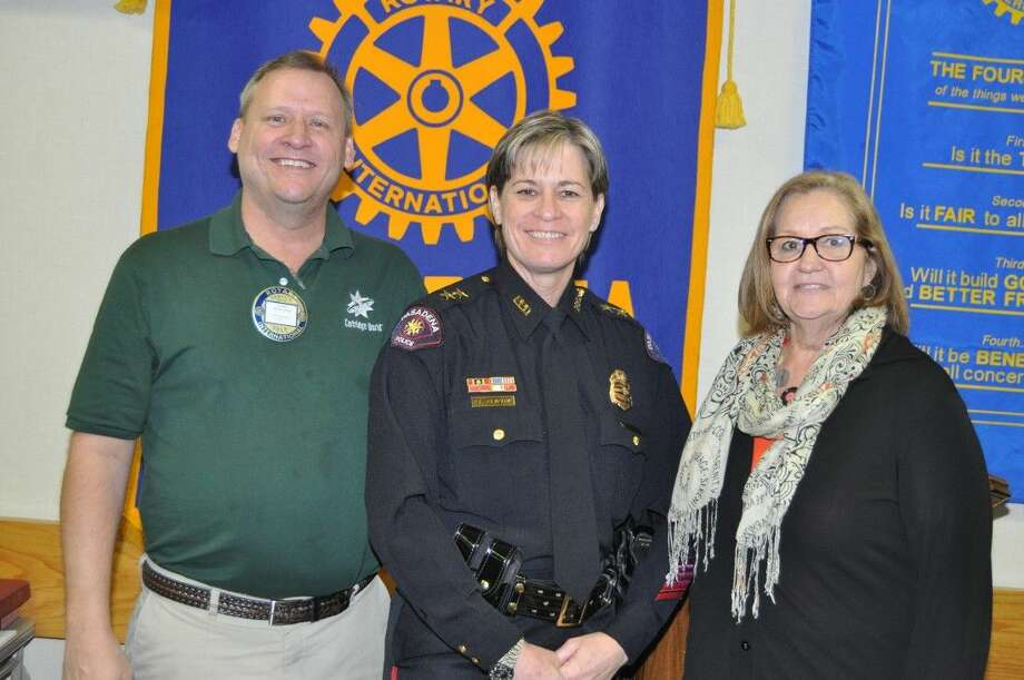 Pasadena Rotary Program Gary Nickelson (L) and Rotarian Debra Mosley (R) welcome guest speaker Assistant Chief of Police Susan Clifton.