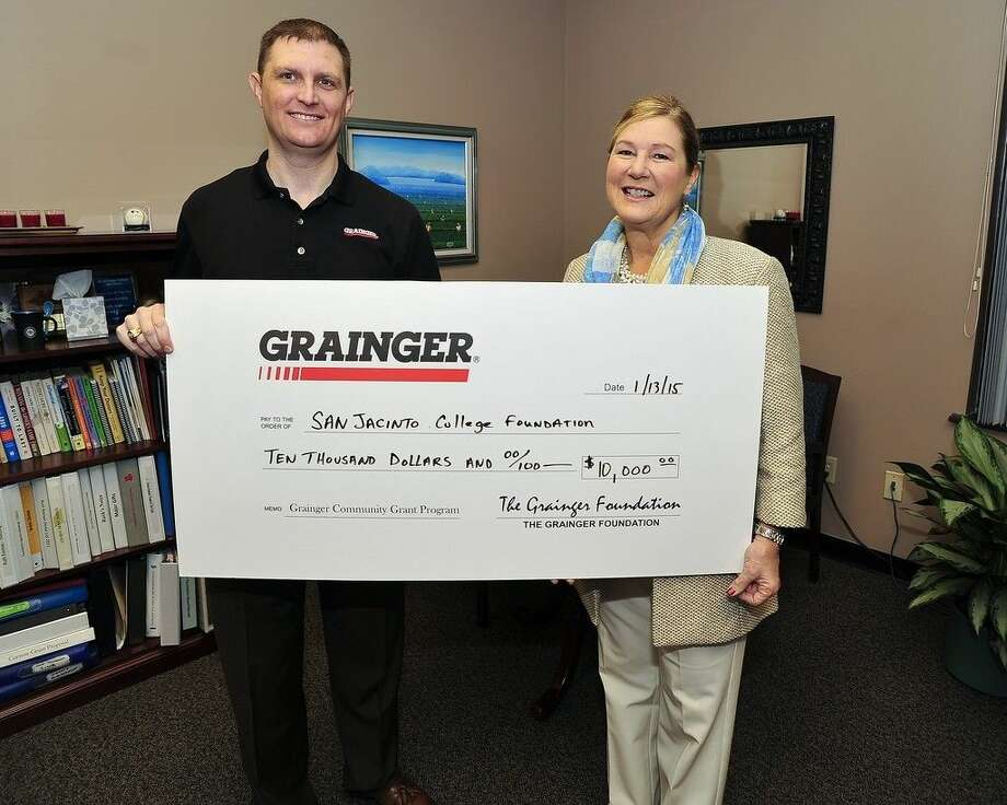 Mark Gour, Market Manager of Grainger's Deer Park location, presents a 10,000 donation to the San Jacinto College Foundation, represented by Ruth Keenan, executive director of the Foundation. Photo credit: Rob Vanya, San Jacinto College marketing, public relations, and government affairs department.