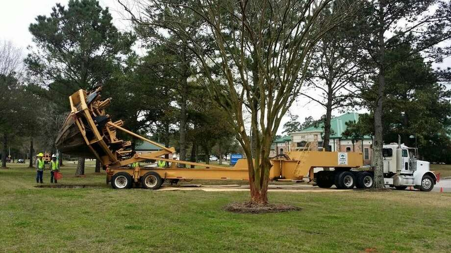 Trees from the Kings Crossing Apartment complex are being moved before demolition and planted in the medians along West Lake Houston Parkway.