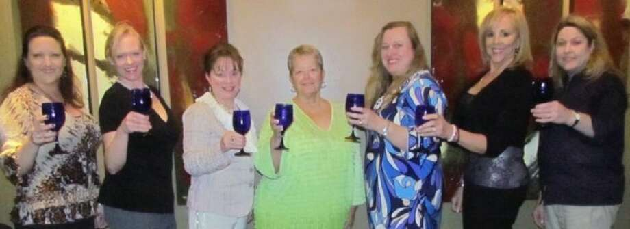 """Raise a Glass to CIS"" committee members (from left) are Angela Jenkins, Kathleen McNeil, Lisa Holbrook, Ann Hammond, Kim Barker, Janet Summers and Terri Divine. Not pictured members are Dinah Matthews, Kaci Hanson, Carol Latimer, Susan Bailey, Kimberly Fleming, Pam Ploss, Tama Brantley and Rene Lewis."