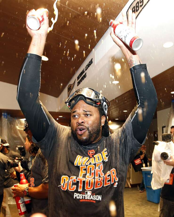 San Francisco Giants' Johnny Cueto celebrates in the clubhouse after the team clinched the National League's second place, wild-card spot following their 7-1 win over the Los Angeles Dodgers in a baseball game in San Francisco, Sunday, Oct. 2, 2016. (AP Photo/Tony Avelar) Photo: Tony Avelar, Associated Press