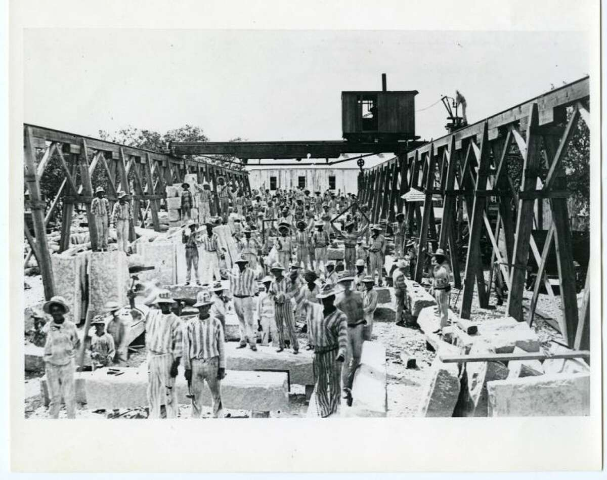 Laborers forced to cut and dress stone for the Texas Capitol under the convict leasing system, circa 1880s.