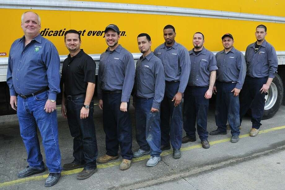 San Jacinto College collision repair technology instructor Glen Kirkwood, far left, is shown with San Jac Certified graduates who work at Penske's Houston regional collision repair center; (from left) Robin Coto (production manager), Elias DeLeon, Jose Salinas, Justin Stewart, Richard Acevedo, Felipe Coca, and Imer Izazaga. Photo credit: Rob Vanya, San Jacinto College marketing, public relations, and government affairs department.