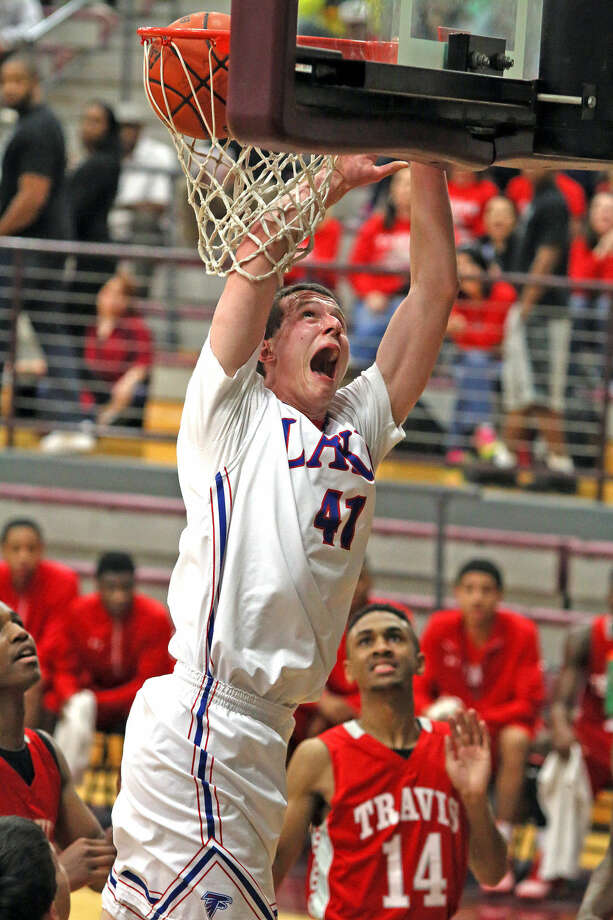 Clear Lake's Alex Westby soars to the basket in the first half against Fort Bend Travis Tuesday night. Photo: Kar B Hlava