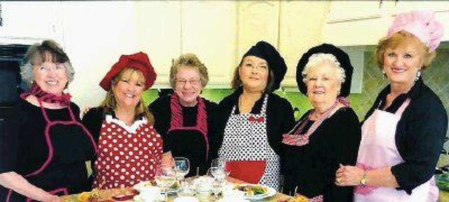 """Pictured in the back row, from left to right, are Kay Caffey, LeeAnn Sprick, Margret Ayers, Victoria Ramirez, Judy Wells and Nancy Foisner, all active """"Heartbeat Bears"""" members.Pictured seated, from left to right, are Donna Wiener, Janet Voytek, Georgia Gray, and Barbara Alcamo, who, surrounded by fresh flowers, savored the delectable gourmet entrees and amazing wines."""