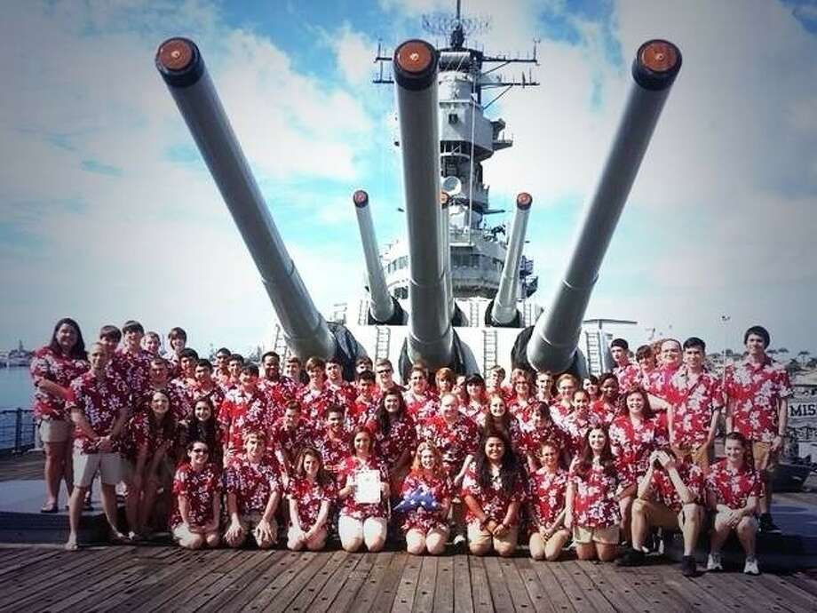 The Big Red Machine marching band of Crosby High School performed a patriotic concert at the USS Missouri in Hawaii. Photo: Submitted Photo
