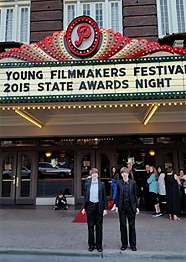 "Langham Creek freshmen Shayne and Kyle Holava stand outside of The Paramount Theatre in Austin, where their film ""The Dollar 2.0"" placed fourth in the Division 2 Animation category of the UIL 2015 Young Filmmakers Festival. Photo: CFISD"