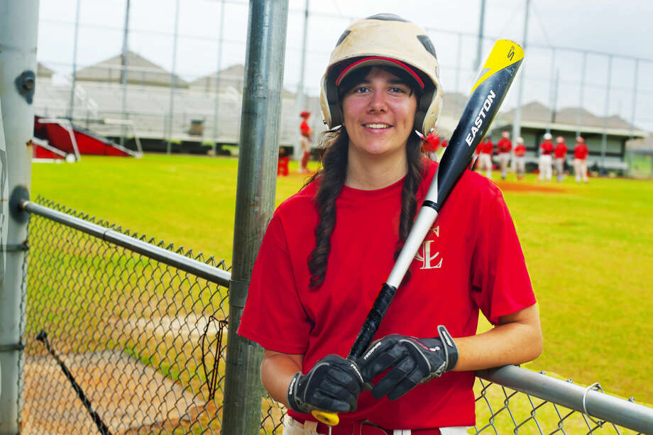 Cy Lakes' Amber Tolleson is the latest example of girls in baseball. The freshman is a pitcher and first baseman for the Spartans' sophomore team. Photo: Tony Gaines/HCN