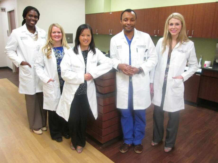 "Memorial Hermann Convenient Care Center now includes three primary care physicians and two nurse practitioners available for ""walk-in"" or by appointment from 7 am to 7pm, seven days a week. Pictured, from left, are Olubunmi Ogundadegbe (Dr. O), M.D., internal medicine and pediatrics; Nurse Practitioner Lisa Fuller; Doan Do, M.D., family medicine; Justin Bogwu, M.D., family medicine; and Nurse Practitioner Lauren Ellison."