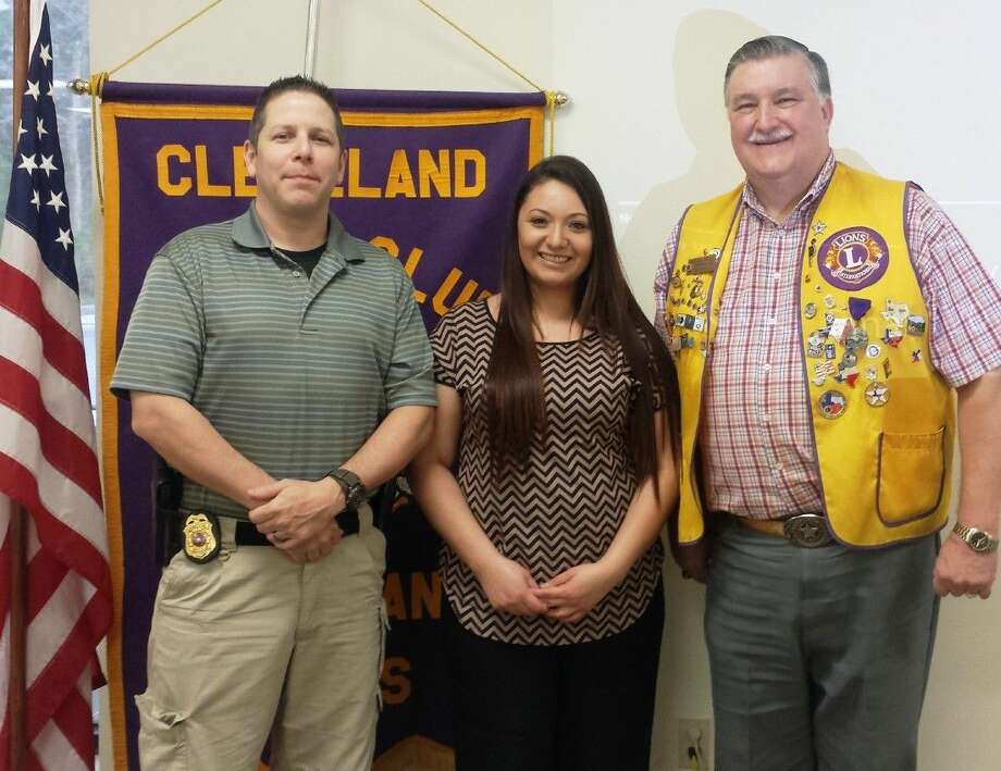 Paula Sanchez (center), executive director of Bridgehaven Children's Advocacy Center, is welcomed to the Cleveland Lions Club on March 3 by Bridgehaven board member and Cleveland Police Capt. Scott Felts and past board member Mike Penry. Photo: Stephanie Buckner