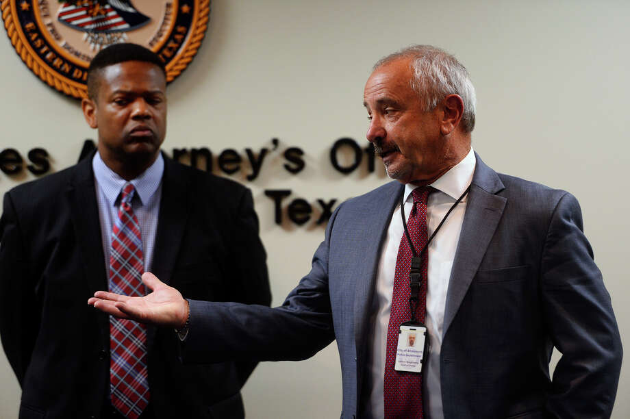 Beaumont Police Chief Jimmy Singletary, right, speaks during a press conference at the United States Attorney's office in Beaumont. Lance Fontenot,  a 23-year-old man from Beaumont, has pleaded guilty to making a bomb threat to the ExxonMobil Beaumont refinery in June. Photo taken Thursday 6/16/16 Ryan Pelham/The Enterprise Photo: Ryan Pelham / ©2016 The Beaumont Enterprise/Ryan Pelham