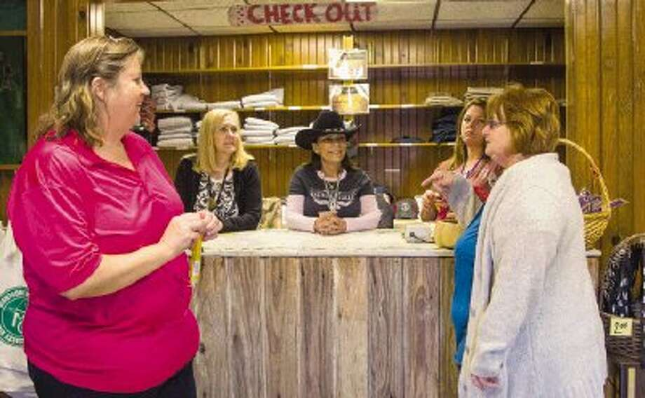 Betty Liles, left, and Zona Jones talk to Judy Cantel, Sissy O'Farrell and Kassandra McCray in The Country Store at the Montgomery County Fair and Rodeo in Conroe Friday. The store sells clothing, quilts, breads and candy. Photo: Staff Photo By Ana Ramirez / The Conroe Courier/ The Woodland