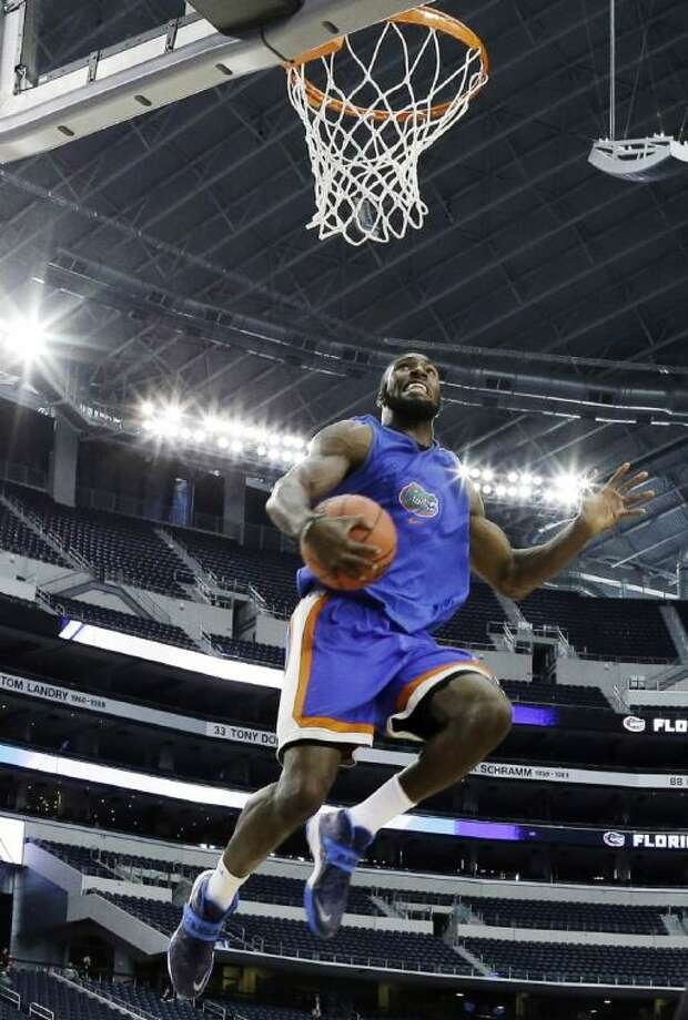 Florida center Patric Young goes up with the ball during practice for an NCAA Final Four game against UConn.