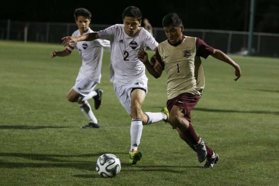 Magnolia West's Diego Ruiz (1) struggles for possession of the ball against Waller's Jorge Alvarado (2) during the high school soccer game on Friday, April 4, 2014, at Tomball High School. To view or purchase this photo and others like it, go to HCNPics.com. Photo: Michael Minasi