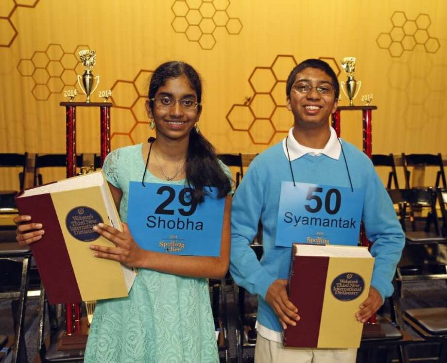 The 2014 Houston Public Media Spelling Bee co-champions win for the second year in a row. (from L to R) Shobha Dasari from Pearland Junior High School West and Syamantak Payra from Westbrook Intermediate School will compete in the Scripps National Spelling Bee. Photo: Craig H. Hartley