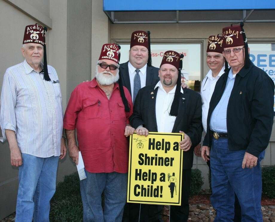 Members of the New Caney Shriners Club greet guests at the Porter IHOP location, where proceeds from National Pancake Day, March 3, were donated to the organization. Photo: Stephanie Buckner