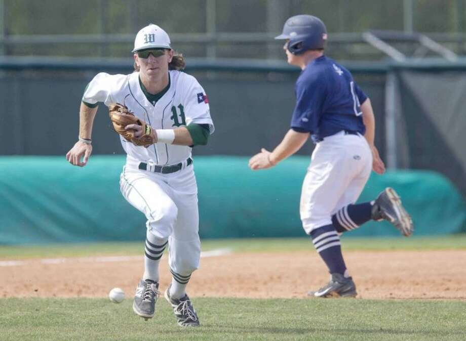 The Woodlands infielder Hillin Warrren chases down the ball after making an error as College Park second baseman Justen Heinrich (4) runs toward third during a high school baseball game Saturday. The Woodlands defeated College Park 4-2. To view or purchase this photo and others like it, visit HCNpics.com.