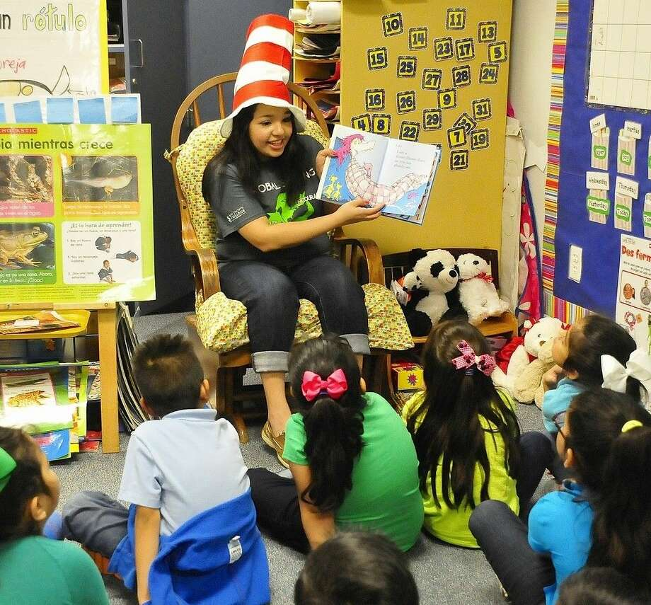 Following an energetic reading of a Dr. Seuss book, San Jacinto College student Kimberly Lopez plays a game with Golden Acres Elementary School children. Lopez visited the school with her San Jacinto College peers in celebration of Read Across America and Dr. Seuss Week. Photo credit: Jeannie Peng-Armao, San Jacinto College marketing, public relations, and government affairs department.