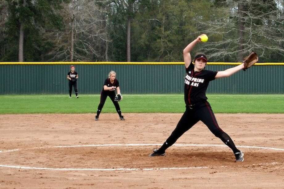 Jessica Lyle pitched for the Trojans against Splendora's Ladycats on Friday, March 28, in a game that was rained out in the sixth, but will be made up Wednesday, April 2. Also shown is Brenna Wolsey at second and Tiffani Huff in right field. Photo: CASEY STINNETT / Houston Community Newspapers, 2014