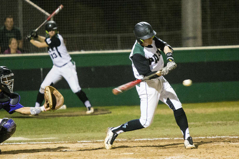 Kingwood Park's Zak Keller (6) hits during Kingwood Park's 3-0 victory over Humble on March 3, 2015, at Kingwood Park High School.