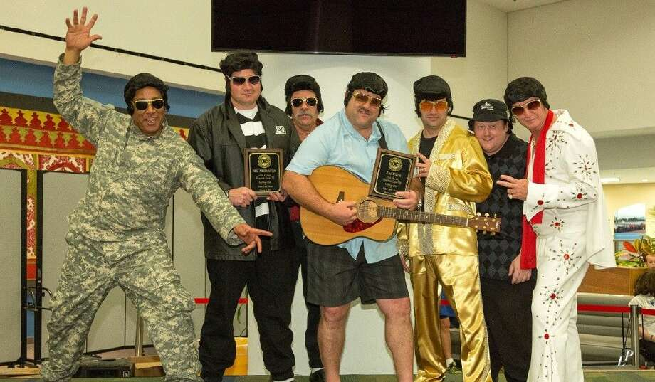 "Members of the FBISD ""Elvis"" team, from left, Sergeant Kenneth Perry, officer James Edge, officer Charles Villoutreix, Chief David Rider, Sergeant Shannon Hall, Clint Stump and Lieutenant Michael Harvey."