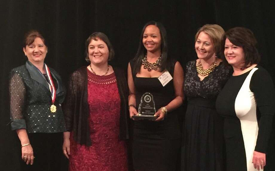 From left, Robin McAdams, Jamie Mount and Winna MacLaren of Humble ISD, Texas School Public Relations Association President Lorette Williams, and Jerri Monbaron of Humble ISD were called to the awards stage at the Texas School Public Relations Association Conference. Humble ISD won a total of 19 awards in the state communications contest.