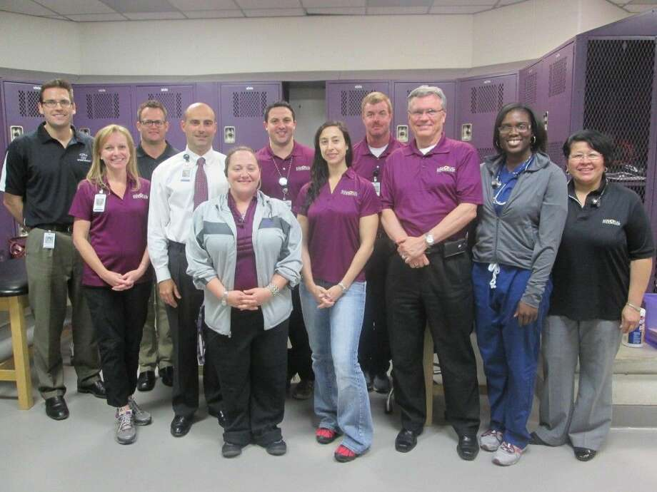 During last year's sports physicals, Humble City Council Member Norman Funderburk, 9th from left, visited the Memorial Hermann Northeast Team in the Humble High School Wildcats locker room. With him, from left, are Wasyl Fedoriw, M.D., Vivien Bond, Shaun Weaver, M.D., Heath Rushing, Humble High School Athletic Trainer Amy Walker, Zayde Radwan, M.D., Rima Cerone, N.P., Robert Maniscalco, Humble City Council Member Norman Funderburk, Olubunmi Ogundadegbe, M.D., and Marixa Maldonado, N.P.