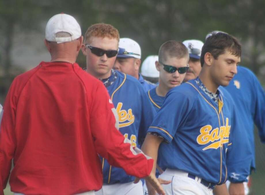FBCA baseball coach David Turner shakes hands with some glum Brazosport Christian players after the Warriors ended a long skid to one of TAPPS' 2A powerhouses this past week.