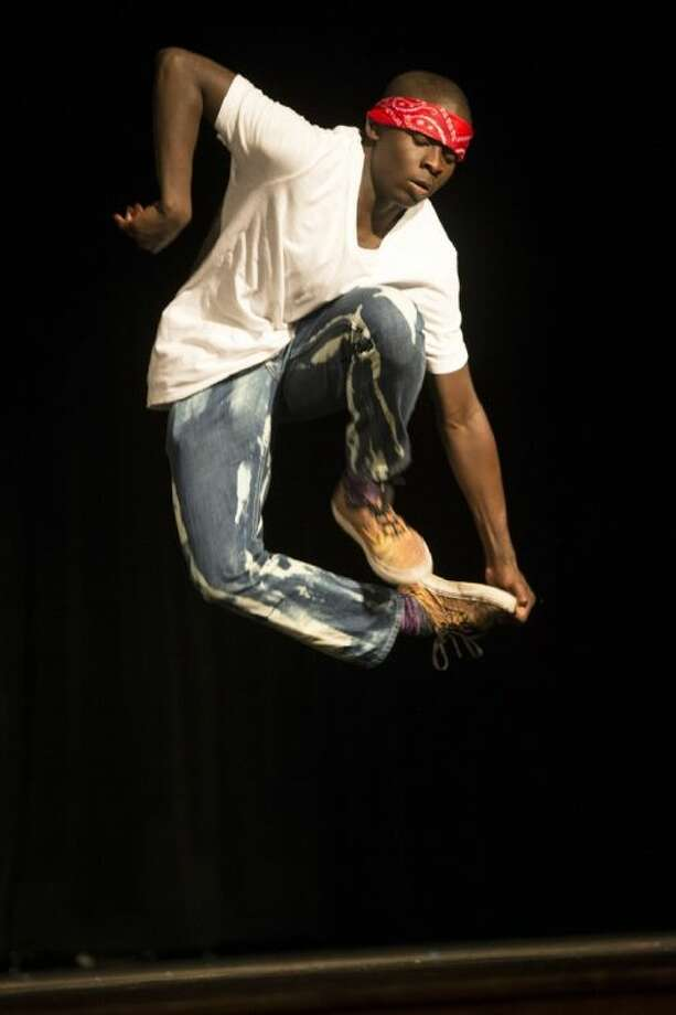 """Darius Mitchell performs a dance routine to the song """"Cinema"""" during the COCISD Talent Show on March 29, 2014, at Coldspring-Oakhurst High School. Photo: ANDREW BUCKLEY"""