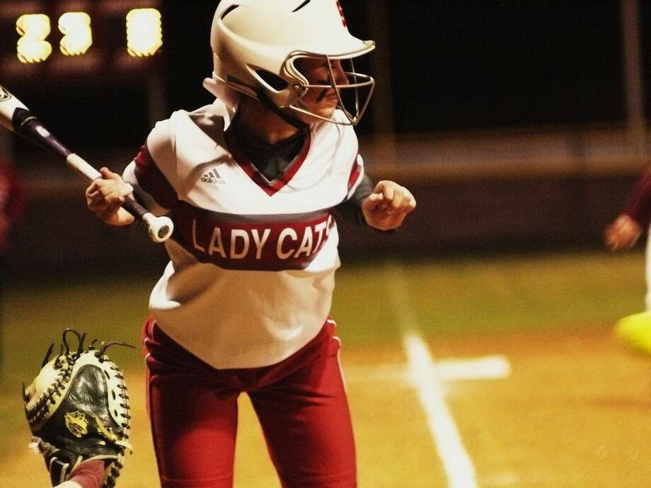 A Splendora Lady Cat dodges one coming in tight at Tarkington Friday night, March 6, 2015. Photo: Casey Stinnett