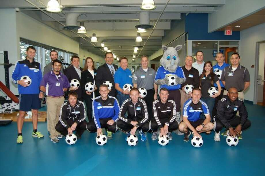 Pictured are representatives of the Texas Rush Soccer Club and St. Luke's Performance Medicine, a department of St. Luke's The Woodlands Hospital, which has partnered with the club to become its official sports medicine provider.
