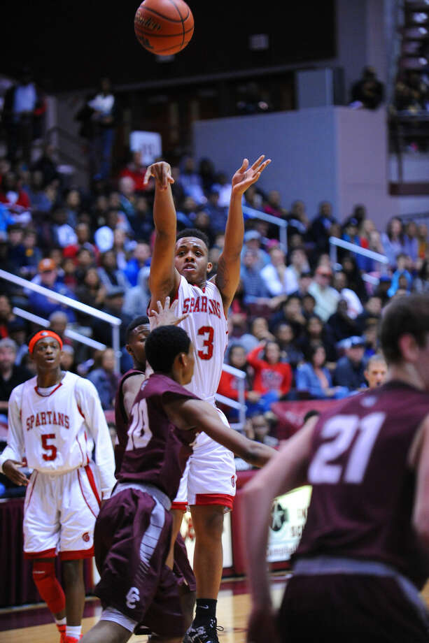 Cy Lakes' Nick Garth shoots over Clear Creek defenders Friday at the Campbell Center. Photo: Tony Gaines/HCN