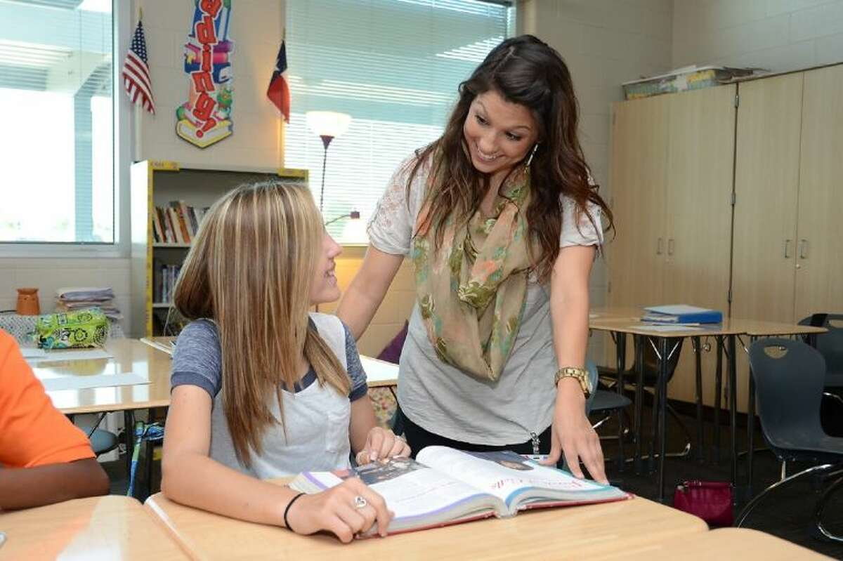#20: Cypress-Fairbanks ISD Growth rate: 1.33 percentEnrollment in 2016-2017: 114,868 Enrollment in 2017-2018: 116,401 Change: +1,533 A Cypress-Fairbanks ISD teacher works with a student.