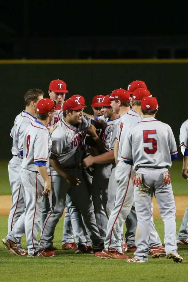 Tomball pitcher Stephen Bonnain (44) is swarmed by teammates after pitching a perfect game against Tomball Memorial on Tuesday, March 25, at Tomball Memorial High School. Photo: Michael Minasi
