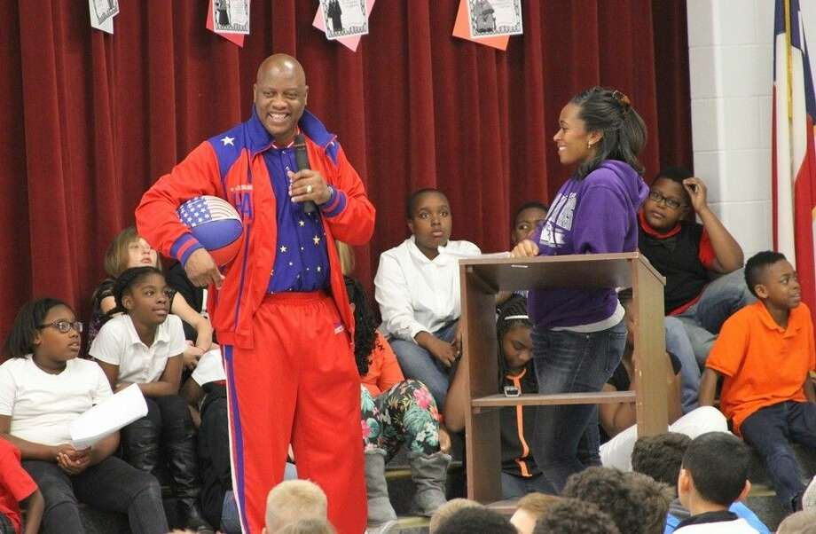 """Former Harlem Globetrotter Reggie """"Air Man"""" Dixon speaks at the Coldspring Intermediate School's Black History Program. Now a member of the Famous Harlem All Star Legends, Dixon encouraged students to work hard, believe in themselves and never stop shooting for their dreams. Photo: Submitted"""