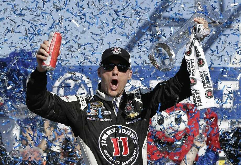 Kevin Harvick celebrates in Victory Lane after winning a NASCAR Sprint Cup race in Las Vegas.