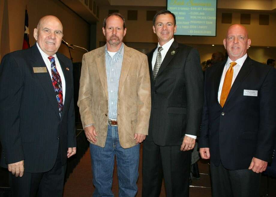 David Gornet (second from right), the executive director of the Grand Parkway Association, spoke at the March 5 membership luncheon of the Greater Cleveland Chamber of Commerce, where he was welcomed by chamber representatives Jim Carson (left), Phillip Cameron and Buck Anderson (right). Photo: Stephanie Buckner