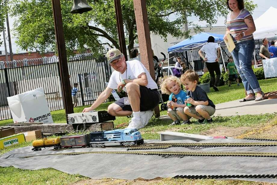 Kids get up close to watch as the track is laid out for Railfest.