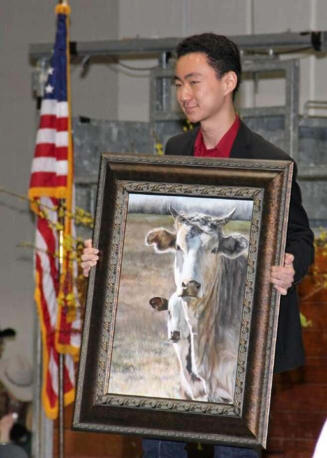 """Dawson High School student Matthew Wu shows his painting, """"Bodyguard,"""" during the Houston Livestock Show and Rodeo School Art Auction. Photo: Courtesy Pearland ISD"""